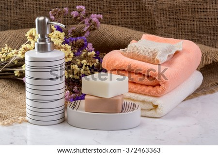 Handmade Soap with bath accessories  on marble background - stock photo