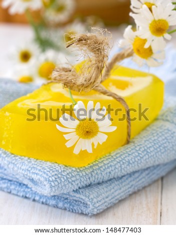 handmade soap with camomiles on the towel - stock photo