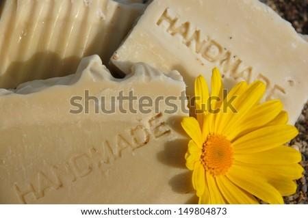 Handmade Soaps with Yellow Daisy - stock photo