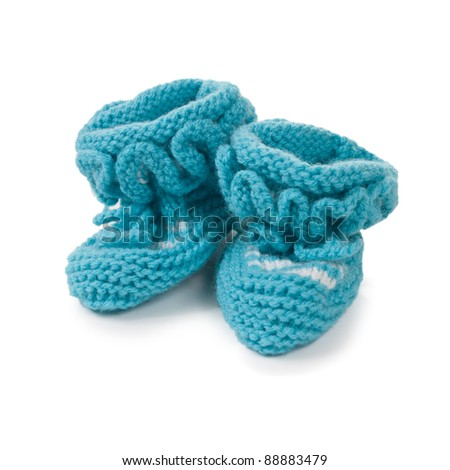 Handmade sweet baby booties isolated on a white background - stock photo