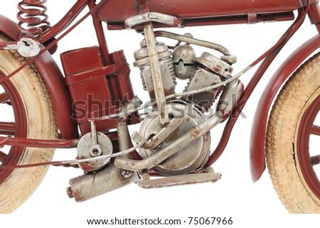Handmade tin 1930's vintage motorcycle model, isolated over white background - stock photo