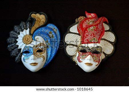 handmade Venetian masks. The colours of the masks are typical of 18th century theatre in Italy. - stock photo