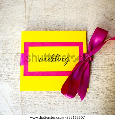Handmade wedding invitations with fuchsia ribbon - stock photo