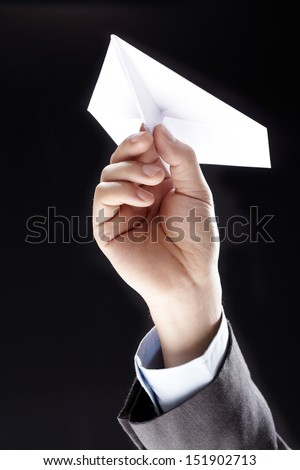Handmade white origami paper plane isolated on black background  - stock photo