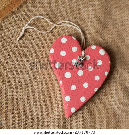 handmade wooden polka dot red heart with love pendant - stock photo