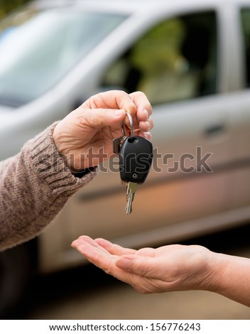 Hands and a car key - stock photo