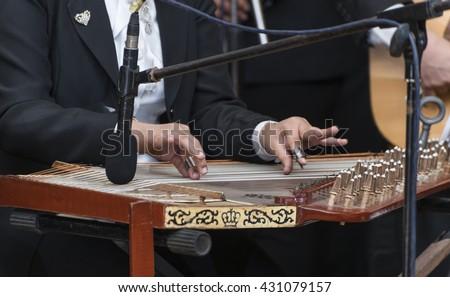 Hands and Arabian Qanon Musical Instrument - stock photo