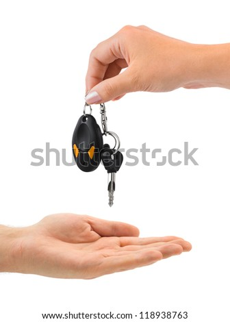 Hands and car key isolated on white background - stock photo