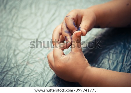 Hands and fingers stained with pen - stock photo