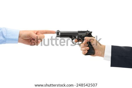 Hands and gun isolated on white background - stock photo