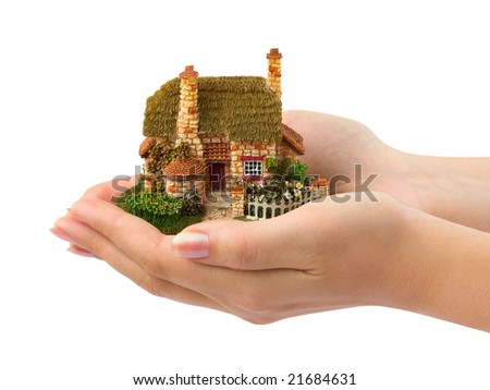 Hands and house isolated on white background - stock photo