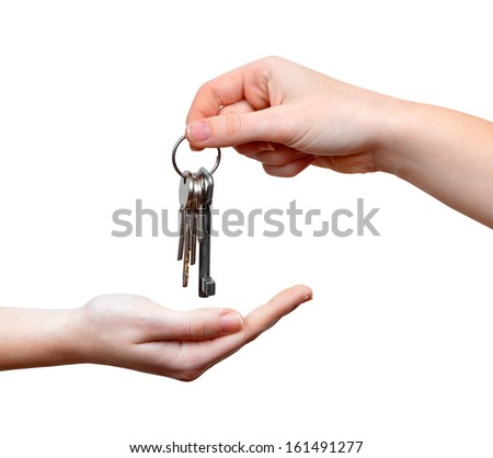 Hands and key isolated on white background  - stock photo