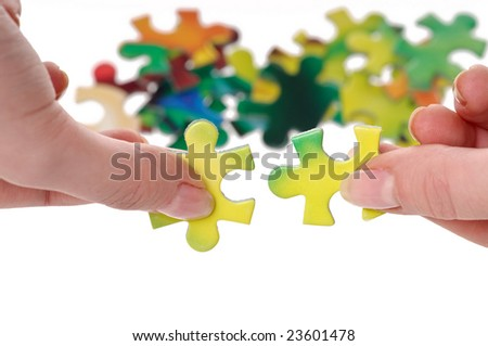Hands and puzzle on white background - stock photo