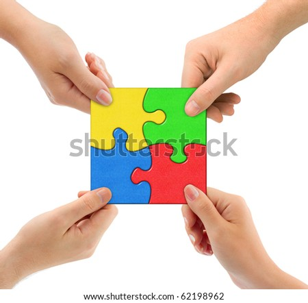 Hands and puzzle Team isolated on white background - stock photo