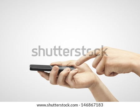 hands are holding and pointing on Smart Phone - stock photo