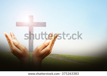 Hands, bless the cross - stock photo