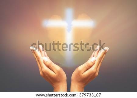 Hands, bless the cross in the sky heart. - stock photo
