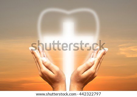 Hands bless the cross in the sky. symbolic representing Jesus - stock photo