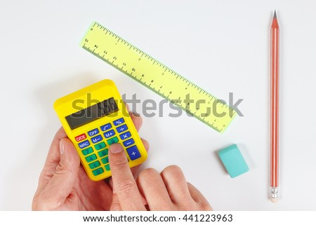 Hands calculate using a calculator over a workplace of the engineer - stock photo