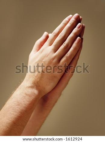 Hands clasped in prayer - stock photo