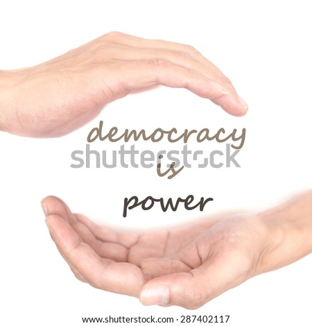 Hands concept for democracy is power. Quote is between right and left hand - stock photo