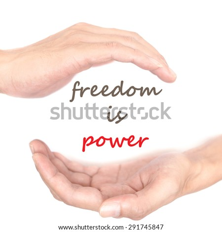 Hands concept for 'freedom is power'. Quote is between right and left hand - stock photo