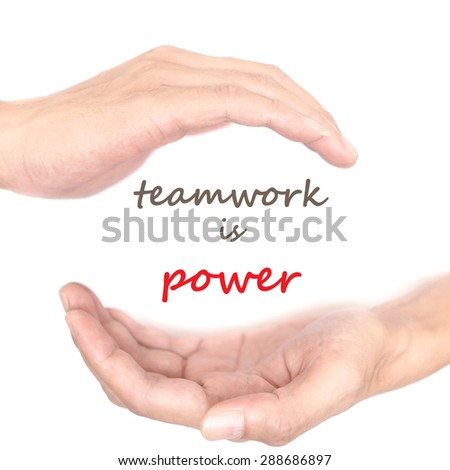 Hands concept for 'teamwork is power'. Quote is between right and left hand - stock photo