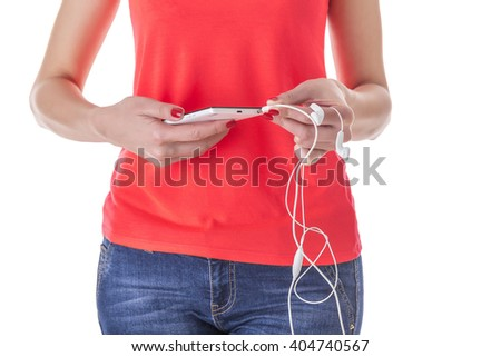 Hands connect headphones to the phone. Silhouette of the girl on a white background. - stock photo