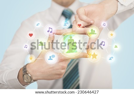 Hands creating a form with social media connection in the center  - stock photo