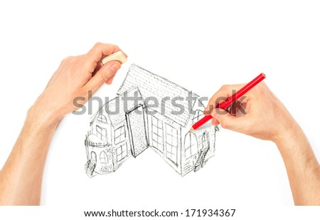 Hands drawing big house on a white background - stock photo