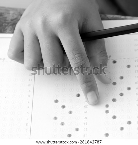 hands examination answer sheet black and white version - stock photo