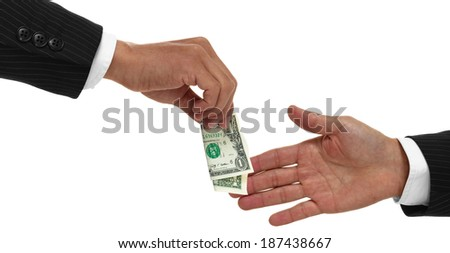 Hands exchanging money or giving money to another close up, - stock photo