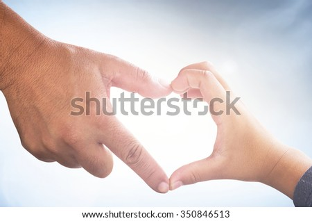 Hands father and son in heart shape. Trust Solidarity Synergy Childhood Love Happy Valentine God Adam Holy Bible Health Care World Cancer Romantic CSR Kid Child Day Belief Kidney Generosity concept. - stock photo