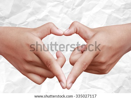 hands fingers love sign heart for pray paris on crumple paper with plenty room for copy - stock photo