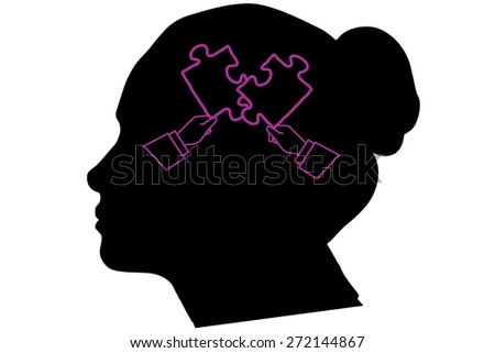 Hands forming jigsaw against silhouette of head - stock photo