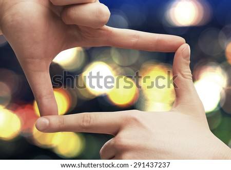 hands frame on a blured background - stock photo