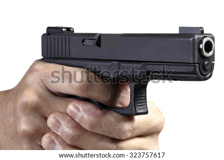 Hands gripping and aiming handgun weapon - stock photo