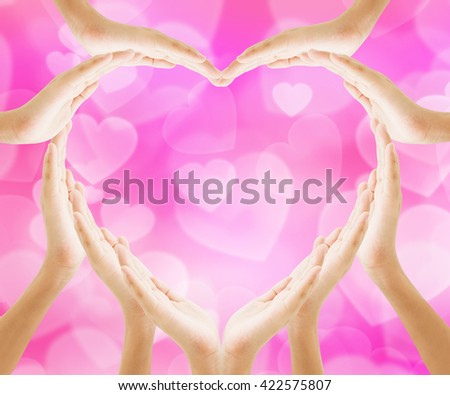 Hands heart shape with pink bokeh heart background , love concept holiday valentine's day - stock photo