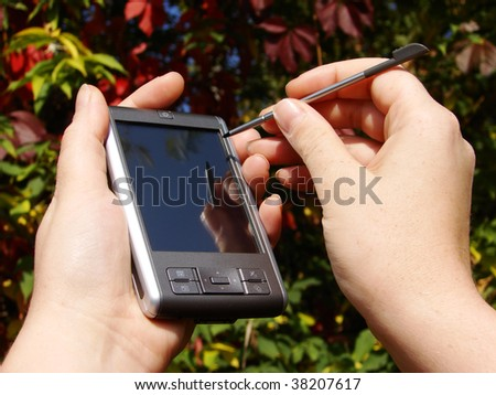 hands hold and pointing  pocket computer - stock photo
