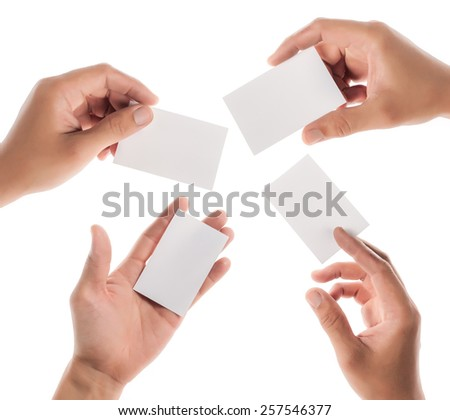 Hands hold business cards on white background - stock photo