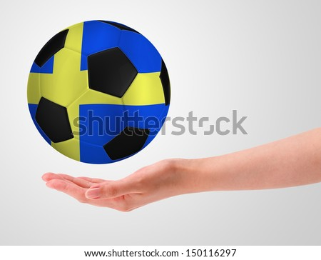 Hands holding a ball with flag of sweden - stock photo