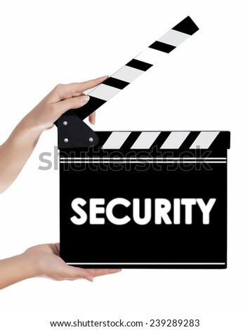 Hands holding a clapper board with SECURITY text - stock photo