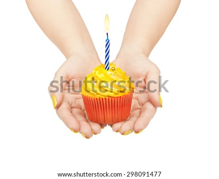 hands holding a cupcake isolated on white background - stock photo