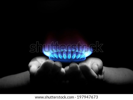 Hands holding a flame gas - stock photo