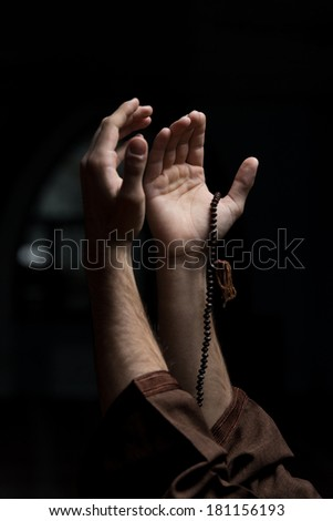 Hands Holding A Muslim Rosary - stock photo