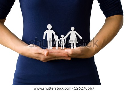 hands holding a paper chain family in front of a body, on white - stock photo