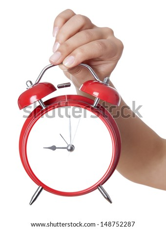 Hands holding a red alarm clock. Isolated on a white background - stock photo