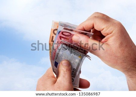 Hands holding banknotes - stock photo