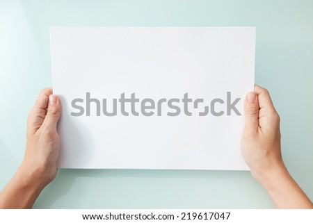 hands holding blank A4 copy space letter - stock photo