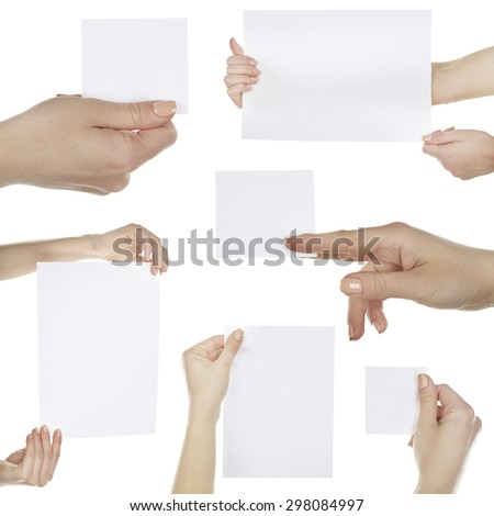 Hands holding blank cards isolated on white - stock photo